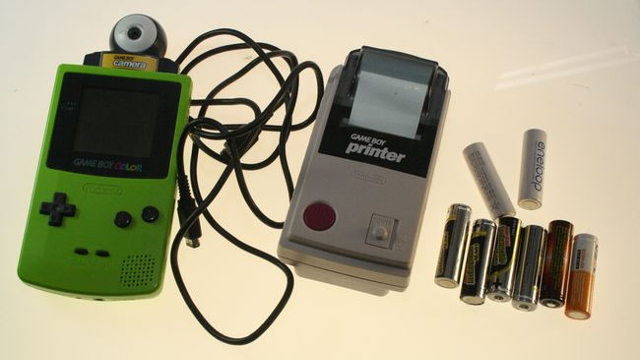 The GameBoy Camera and Printer. So you can take awful 8bit photos and keep them forever on receipt paper.
